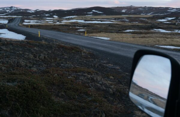 Iceland, Country Road Reflecting In Van Mirror