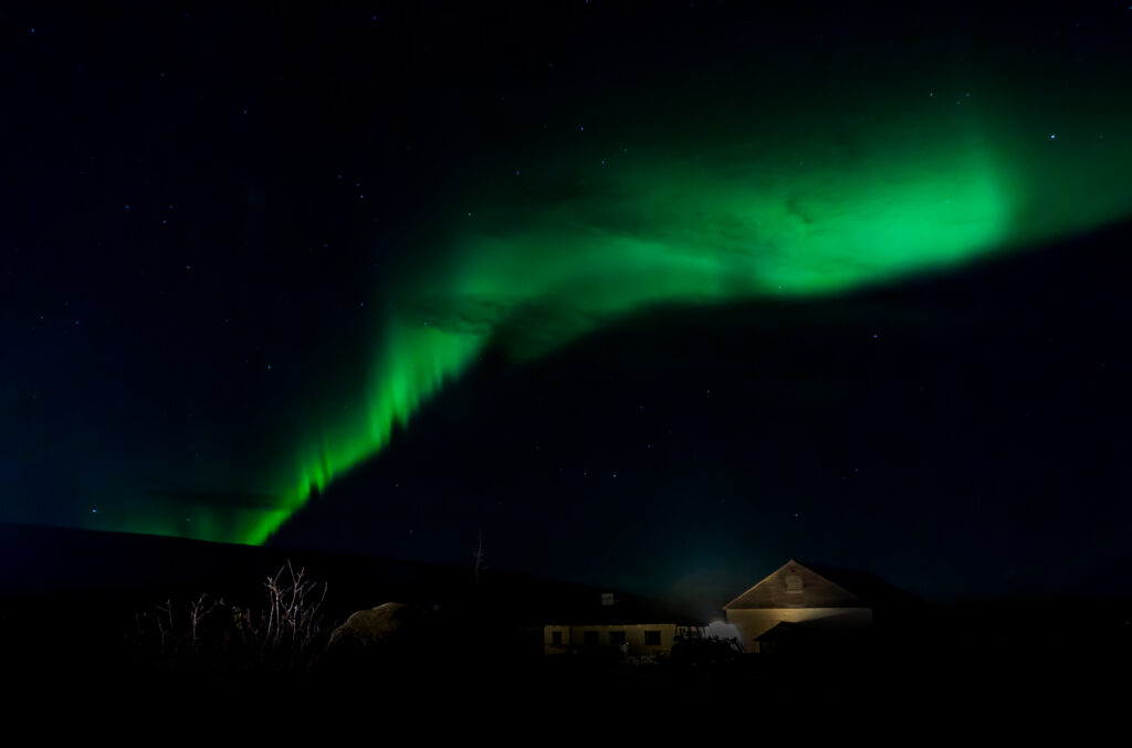 Iceland, Northern Lights (Aurora Borealis) Above Farmhouse