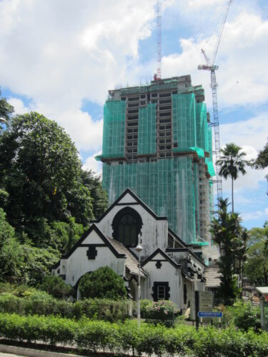 Malaysia - Kuala Lumpur, Church In Front Of Construction Site