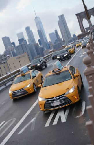 New York - Brooklyn Bridge, Taxis In Front Of Skyline