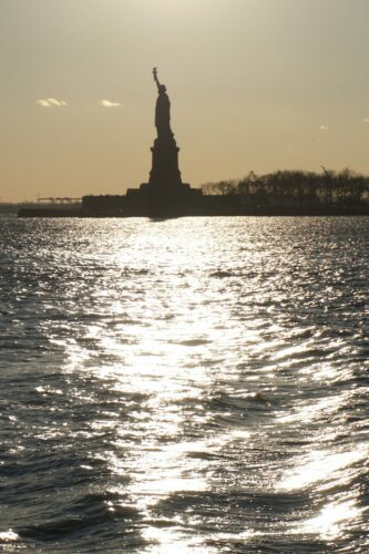 New York, Statue Of Liberty In Sunset