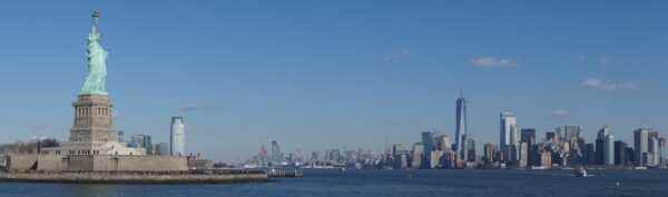 New York - Statue Of Liberty, View To Manhattan Skyline