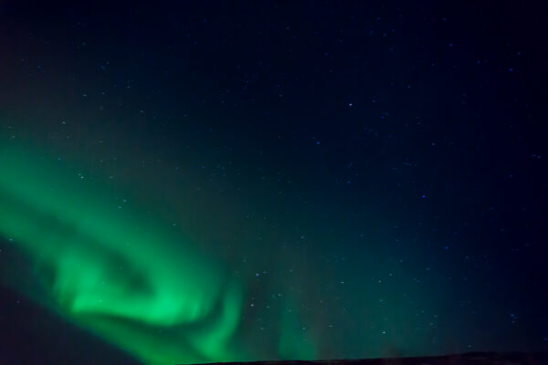 Northern Lights (Aurora Borealis) At Icelandic Night Sky