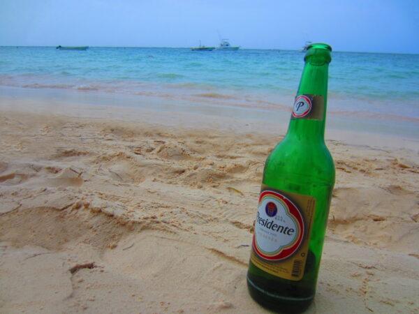 Republica Dominicana, Presidente Beer Bottle On Beach